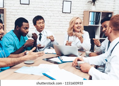 Multinational Doctor's Meeting. Resting Concept. Medical Office. Cups Of Tea. Coffee Break. Cheerful Medicians. Working Together. Workers Friendship. Teamwork Connection. Hospital Team.