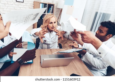 Multinational Doctor's Showing Documents To The Chief. Female Nervous Medician. Angry Refuse. Specialist's Bad Mood. Professional Medical Arguing. Working Together. Test Results. Hospital Meeting.
