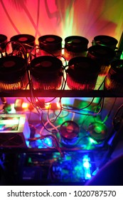 Multiple 1st generation Asic miner, CPU, Fan power supply turn up become home mini mining machine action with long shutter exposure light Art