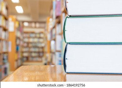 Multiple books piled up in the library