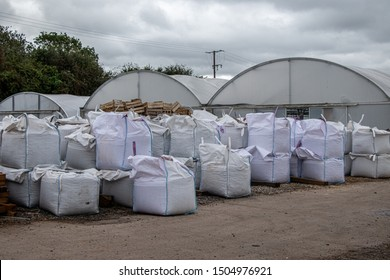 Multiple bulk bags outside of a builders merchants.