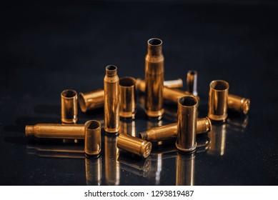Multiple caliber bullet shells on a black background