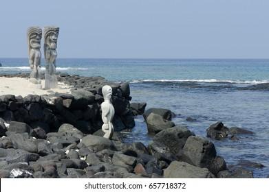 Multiple carved wooden statues protect sacred grounds at Pu'uhonua o Honaunau National Historical Park, Hawaii Island.