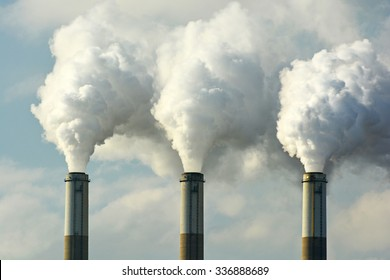 Multiple Coal Fossil Fuel Power Plant Smokestacks Emit Carbon Dioxide Pollution