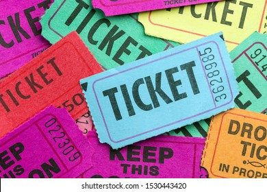 Multiple color paper show tickets in pile