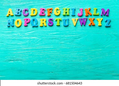 Multiple colored letters on wooden table
