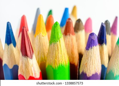 Multiple colored pencils on a white background. Macro