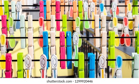 Multiple colorful clothespins hanging