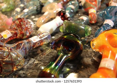 Multiple Colorful Handmade Glass Tobacco or Marijuana Pipes on Display for Sale