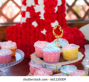Multiple colorful nicely decorated muffins on a wooden background, on birthday celebrations the concept of homemade baking and hospitality at home