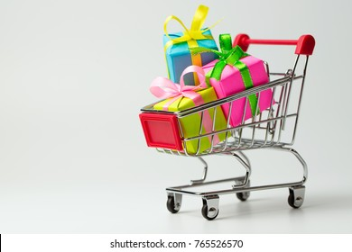 Multiple colors gift or presents boxes in a shopping cart, for sales promotion and rewards concept