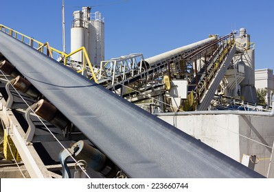 Multiple conveyor belts are used at a processing site.