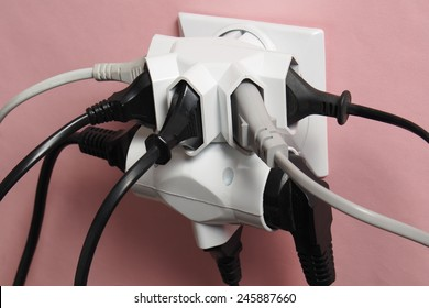 Multiple electric plugs in wall outlet