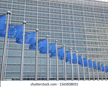 Multiple European Union flags outside the European Commission headquarters (berlaymont) in Brussels, Belgium.