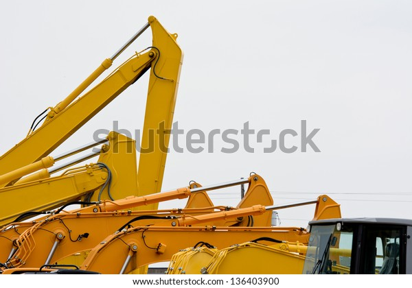 Multiple Excavator Boom Arms On Construction Stock Photo