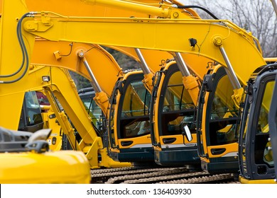 Multiple Excavator Cabs all in a row on Construction Equipment