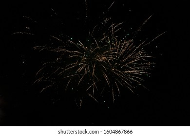 multiple explosion of one firework in the distance