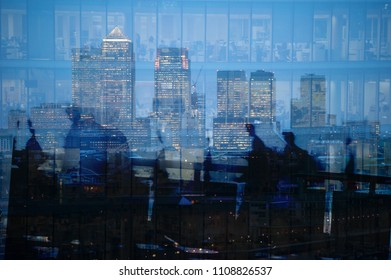 Multiple exposure of blurred city commuters walking and city skyscrapers in London, UK. Concept for management, corporate strategies, future, employment, digital transformation, business, finance.