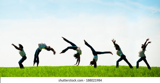 Multiple exposure capturing an African American woman doing a back flip in a beautiful field.