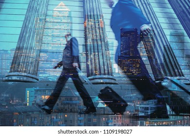Multiple exposure of city commuters walking with trolleys and skyscrapers of the financial district in London, UK. Concept for management, corporate strategies, future cities, employment, finance