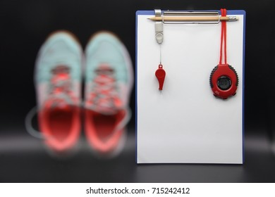 Multiple Exposure image of Blurry Shoe selective focus at Stopwatch and red whistle on dark background