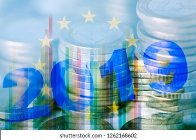 a multiple exposure of some piles of euro coins, some charts, the flag of the european union and the number 2019, as the new year