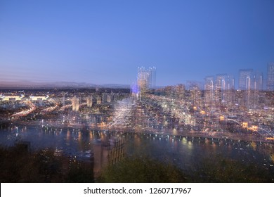 Multiple exposures, done in camera, of the downtown cityscape in Pittsburgh, Pennsylvania, at dusk.