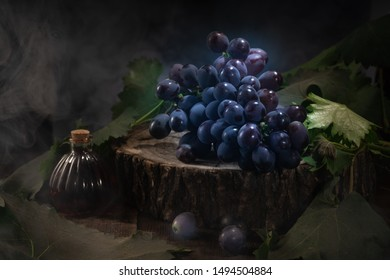 Multiple grape bunches on a wooden board against a dark background