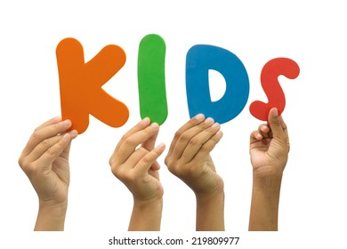 Multiple hands holding kids word