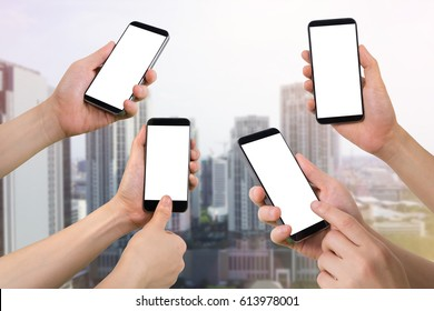 multiple human hand hold ,smartphone, tablet, cell phone on city building background.