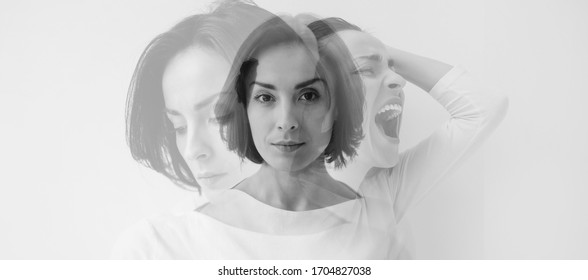 Multiple identities. Close-up photo of a young pretty brunette girl who is looking in the camera while internally suffering from a dissociative identity disorder. Double exposure.