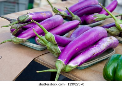 Multiple Japanese Eggplants at the Farmers Market