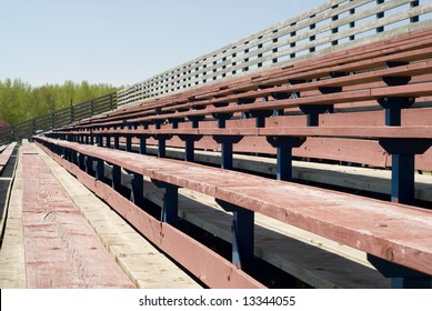 Multiple levels of wooden bleachers used for watching sporting events