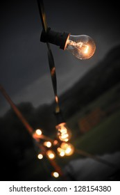 Multiple light bulbs on string bokeh