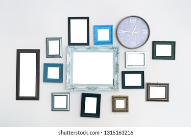 Multiple many blank photo frames on white wall