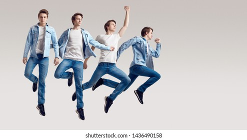 Multiple portrait of a jumping handsome hipster man wearing jeans jacket on white background in studio