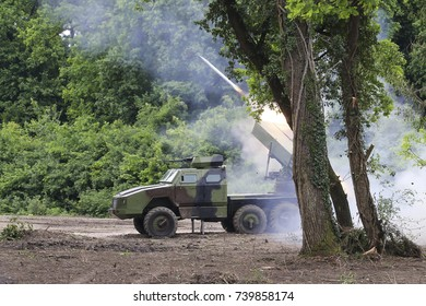 "multiple rocket launcher BM-21 ""Grad"" acting on goals. Russian military vehicle"