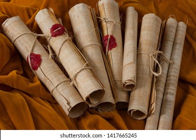 multiple scrolls and seals thrown in a heap