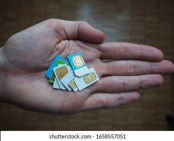 Multiple Sim cards presented in a Hand to viewer for sale