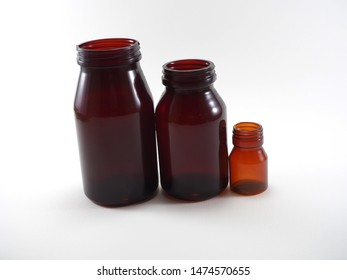 Multiple size of plastic bottle which made from PVC (Polyvinyl chloride). Variety color of light to dark brown. Medicine packaging. Plastic look like glass.