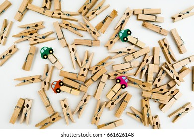 Multiple small wooden cloth pegs scattered on table top.