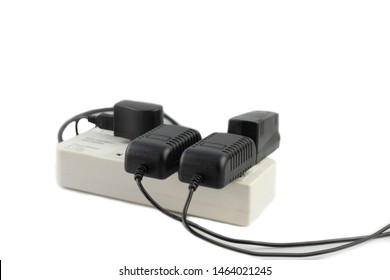 Multiple socket with connected power Strip with a bunch of plugs and adapter on white background