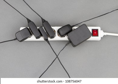 multiple socket with many power supplies in grey background