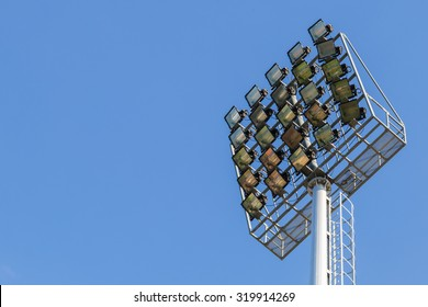 Multiple sport light with blue background, spotlight and place for text