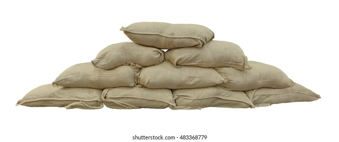 Multiple stacked sand bags, isolated on white background