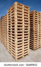 multiple stacks of wooden pallets