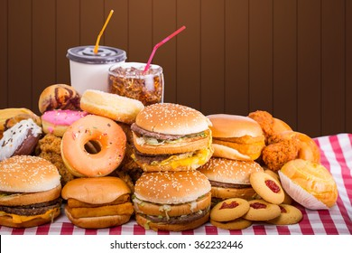 Multiple type of Fast food on table.