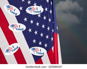 Multiple I Voted stickers with USA flag on stormy background illustrating potential voter fraud with illegal votes and need for recount