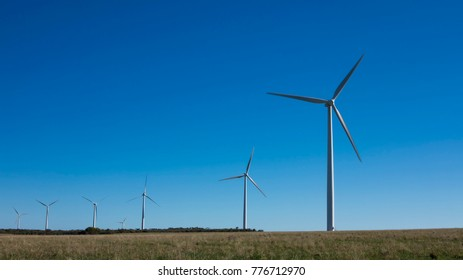 Multiple Wind Turbines against a Blue Sky