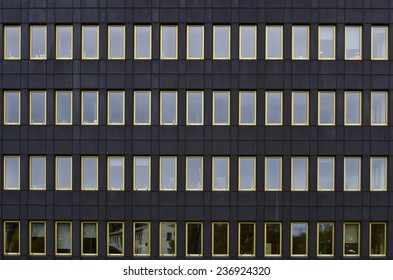 Multiple windows on a local power-supply company in Skelleftea, Sweden, and the facade is covered in copper-plates which has turned green over the years.